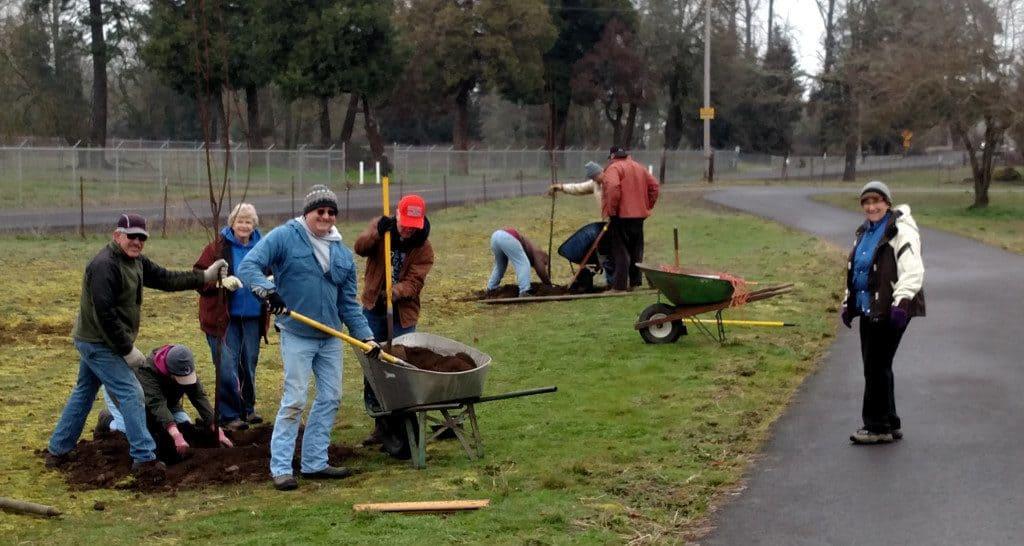 Happy BLT volunteers planting trees