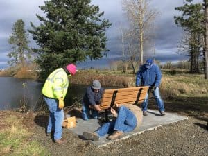 Installing benches at Cheadle Lake, March 2, 2018