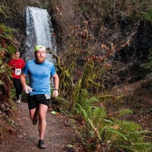 Trevor Spangle running waterfall background