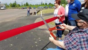 Lebanon mayor Paul Aziz cuts the ribbon, Suzie Black in background